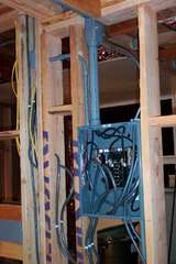 Double-ought (#00 awg.) runs from my 200A house panel to my room's sub-panel (which opens to the hallway formed by the side wall.  Mostly Hovland MainLine cable throughout walls, but also some twisted